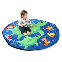 Under the Sea Giant Snuggle Mat: Brightly coloured, highly detailed turtle themed giant floor snuggle mat made of plush and tactile materials. Comfortable for children to sit rest and play on. Made with soft and durable textures and heavy duty stitching which make this mat ideal for schools and nurseries.  : Dia/H: 1.5m x 2.5cm