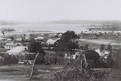 Teralba from Rhondda Road c.1910, looking east. Original weatherboard Great Northern Hotel, centre left. Train at railway station left hand side. Cockle Bay in backgound. Note clothesline with props, and absence of mangroves in Cockle Creek delta.