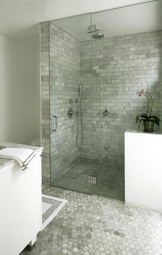 LA Times - Bianco carrara marble hexagon tile bathroom floor, Seamless glass shower with bianco carrara marble subway tile shower surround