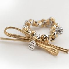 A traditional bracelet gets turned on as it features a gold twist with a leather bow. Pairing with other bracelets is highly encouraged.  Designed by Bomish