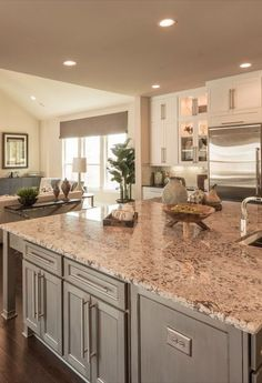 A couple of green elements to liven up this kitchen! Taupe Kitchen Cabinets, Kitchen Cabinet Colors, Granite Kitchen, Kitchen Paint, Kitchen Redo, Kitchen Colors, Home Decor Kitchen, New Kitchen, Home Kitchens