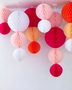 Hanging Globe Decorations  String together store-bought paper decorations in various colors and sizes to create a showpiece full of visual interest.