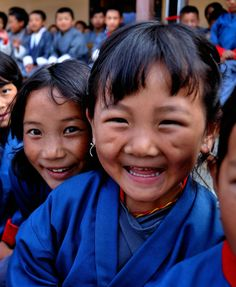 """""""happy faces from bhutan"""" by ryanne { trimmed reality } on Flickr - These dear children live in Bhutan, officially the Kingdom of Bhutan, is a landlocked country in South Asia located at the eastern end of the Himalayas. It is bordered to the north by China and to the south, east and west by India."""