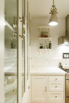 A Designer's Serene Brooklyn Brownstone | Design*Sponge ~ETs #vintagelighting #glasspantry