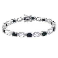 """I've tagged a product on Zales: Oval Black Sapphire and White Topaz Bracelet in Sterling Silver - 7.25"""""""