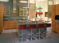 Interior, Bar Design For Home Designs Mixed With Rectangle Gray Table With Glass Top Surface And Four Red Acrylic Bar Stools Also Wooden Kitchne Cabinet Over Gray Floor Tile: How To Determine the Gorgeous Bar Designs For The House