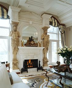 The two antique Hermes salvaged from a war torn building in Austria provide strong architectural character to the fireplace in this highly detailed great room. Fabrics are from Stroheim, through Marie-Howard showroom.  Photo by Beth Singer. Schaerer Architextural Interiors Robert Schaerer - Bloomfield Hills, MI