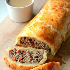 Minced Beef Wellington Recipe Main Dishes with onions, carrots, celery, potatoes, rosemary leaves, olive oil, garlic, minced beef, salt, large eggs, puff pastry