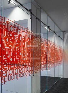 Love the combination of overlapping text and color for these office window graphics! Design Loft, Office Space Design, Office Interior Design, Wall Design, Design Design, Design Ideas, Office Graphics, Window Graphics, Environmental Graphic Design