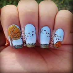 Continuous leaf nail art design. A quirky yet very interesting nail art design where the nails are continuing image from one to another. The nail art depicts the leaves being blown away by a wind on a meadow.