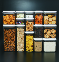 "POP Containers, our latest OXO addiction, let you store everything from crackers to oats to pasta in plain sight. Designed for modular stacking, the square and rectangular shapes make storage a snap. Speaking of ""snap,"" sealing them couldn't be easier — just push the button for an airtight seal. To open, push the button again. It pops up and becomes the handle. Genius."
