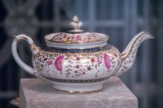 """Porcelain teapot painted in enamel colors and gold. Painted pattern no. """"2/66"""" in gold. From Coalport, Shropshire, 1820-1825. Norwich Castle Museum"""