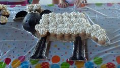 Shaun the sheep cupcake cake. I made the head out of rice crispie treats covered in modeling chocolate. Trying to think of other characters I could use this method for :)