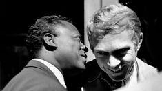 Miles Davis talks to Steve McQueen at the 1963 Monterey Jazz Festival