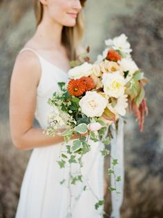 white, orange and green blooms in this desert inspired bouquet