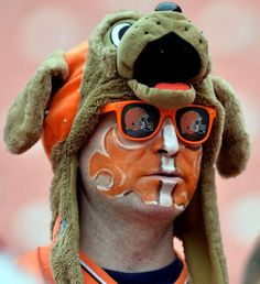 A Cleveland Browns fan watches the game between the San Francisco 49ers and the Cleveland Browns, De... - David Richard/AP