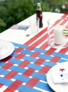 of July Table Runner Cover a table with a white paper tablecloth; snip lengths of blue and red crepe paper to the lengths of the cloth. Weave the colors, as shown; affix at table's edges with double-sided tape. Read more: Fourth of July Party Decor 4. Juli Party, Party Knaller, Party Pops, Festa Party, 4th Of July Party, Fourth Of July, Party Time, Party Ideas, Blue Party