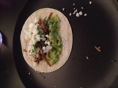 HOME MADE BARBACOA BEEF TACOS: 5 cloves garlic, 1/2 onion, juice of 1/2 lime, 2-4 chipotles in adobo sauce, 1TBS ground cumin, 1 TBS oregano, 1/2 tsp ground cloves, salt and pepper blended then put in a crockpot with 1 cup water and a 3 lbs bottom round roast on high for 5-7 hours then shredded makes the BEST Barbacoa beef!!! Pair with white corn tortillas, chopped onion and cilantro, sour cream and guacamole makes the perfect east dinner!!