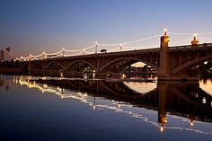 Mill Ave. Bridge in Tempe, AZ is right near the Arizona State University campus. It is home to fishing, boating and paddle boating activities. Many are drawn to the heart of Mill Ave. for nightly activites at its restaurants and bars.