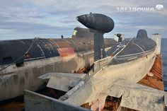 Russian submarines secured on M/V Transshelf to a repair yard