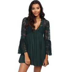 """""""With Love From India"""" free people dress NWT! Beautiful emerald green free people baby doll dress! Brand new with tags. Gorgeous color. Beautiful lace details and fun boho flowy sleeves! This is a stunner! Size Medium and fits true to size. Free People Dresses"""