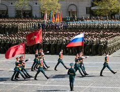 The color guard of the Russian Army Guard of Honor marching through Red Square carrying the State Flag of the Russian Federation, the Victory Banner, and the Flag of the Russian Armed Forces in the 2013 Moscow Victory Day Parade.