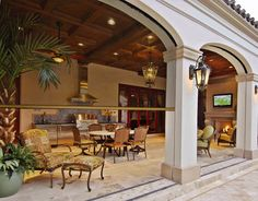 Phantom Screens automatically lower to screen in a patio or cabana, then raise and disappear into their discrete slot.