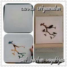 Canvas uitgesneden met houten vogeltjes erop geplakt van de Action