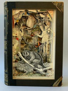 Alexander Korzer-Robinson: Cut Book Art - Daily Art Fixx - a . Middle School Art, Art School, High School, Tunnel Book, Cut Out Art, Altered Book Art, Book Sculpture, Paper Sculptures, 3d Studio
