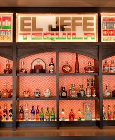 I love all the colored bottles on the shelf... Tequila!