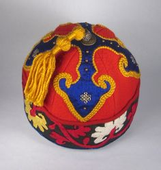 """""""Cloud Collar"""" style, based on a Mongolian design element.  Blue silk on red wool with gold braid outline and Turkish suzuri textile as the cuff."""