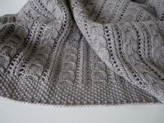 Cuddle Me - free pattern by maanel - a cosy baby blanket with little cables and easy lace pattern.