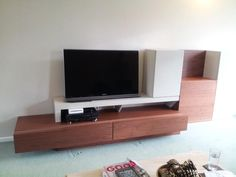 NAT living combination P in Walnut and Sand finish. Composition is a combination of low drawer unit, cabinets and TV stand. Delivered to our client in London. Contemporary Living Room Furniture, Living Furniture, Drawer Unit, Natural Living, Mumbai, Cabinets, Composition, It Is Finished, London