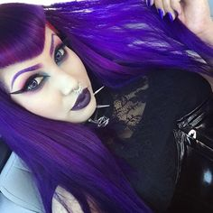 Purple hair with V bangs and matching purple make-up