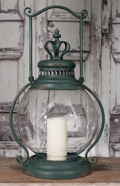 """13½""""W x 11""""D x 24""""T. Includes a glass chimney. Candle is not included."""