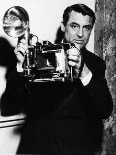 Cary Grant.  How boring this would look with one of today's digital compacts!