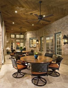 Love the brick and French doors. Would run wood in ceiling lengthwise instead. Cleaner lines against business of the brick walls.