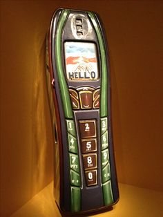 Coffin decorated like a cell phone in the African Art Museum in DC