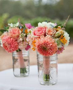 Mason jars at head table for the bridal party to put their bouquets. Then it just serves as part of decorations.