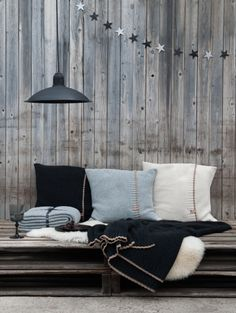 Dress your sofa with the lambs wool cushions and throws / blankets of kiem. In the colors, dark gray, middle gray and off white | www.kiem-wayoflife.com