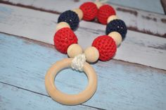 Looking for a great baby shower gift or gift for a new mom?  Look no further!!! #crochetbeadnecklace #teeethingnecklace #nursingnecklace #teething #ecofriendlybaby #ecofriendlybabytoy #teethingring