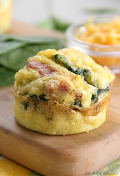 Low-Carb Egg Muffins-delicious with fresh minced basil, garlic, and goat cheese ( instead of cheddar...)