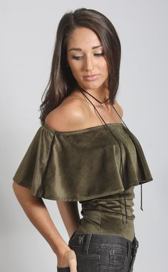 Ow ow!! 😍😍😍 The 70's vibes are real with this groovy bodysuit! It features an on trend off the shoulder silhouette in a beautiful olive velvet fabric. Pair it with high waisted skinnies and booties to