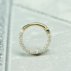 I'd take this over a wedding ring any day: 14 Carat Solid Yellow Gold 16 Gauge 5/16 Septum Ring. by Hindged, $231.77