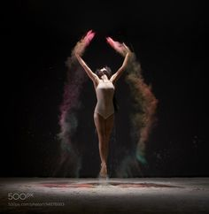 Gymnast streches body up in color dust cloud by AndreyGuryanov1