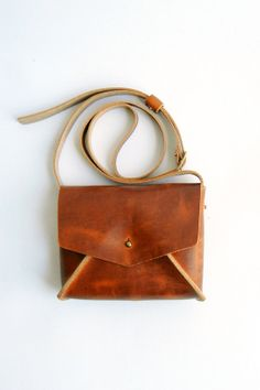 Hey, I found this really awesome Etsy listing at http://www.etsy.com/listing/155217982/cognac-brown-leather-mini-crossbody-bag