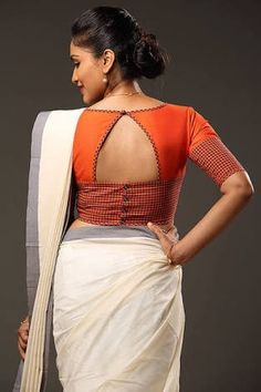 Blouse designs accentuate the looks of the wearer. For a classy and sophisticated look, try these amazing blouse designs which can win you many appreciatio Simple Blouse Designs, Stylish Blouse Design, Blouse Back Neck Designs, Patch Work Blouse Designs, Shirt Designs, Sari Design, Choli Designs, Designer Kurtis, Cotton Saree Blouse Designs