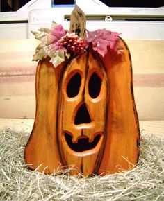 """This hand-crafted Jack o Lantern – Pumpkin was crafted out of pine and measures 9"""" wide by 13"""" tall. Two pieces of pine were laminated together"""