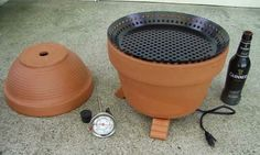 Make A DIY Flower-Pot Smoker popular smokers can cost hundreds of dollars. Luckily, you can build your own with just a few flower pots, a hot plate, a skillet and a saucepan. Diy Flowers, Flower Pots, Diy Smoker, Food Smoker, Smoking Meat, Clay Pots, Outdoor Projects, Diy Projects To Try, Diy Food
