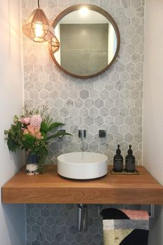 Make a statement in a tiny powder room. Carrara marble hexagon tiles offset by handmade timber vanity top. Designed and styled by me. Bad Inspiration, Bathroom Inspiration, Small Bathroom Sinks, Bathroom Black, Bathroom Closet, Bathroom Feature Wall Tile, Wall Tiles, Bathroom Ideas, Bathroom Tiling